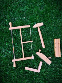 wooden toy tools on grass - image gratuit #329169