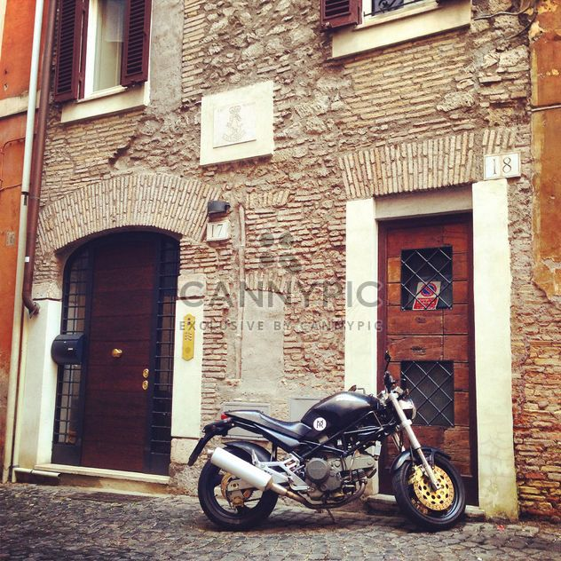 Ducati motorcycle near house - Free image #331109