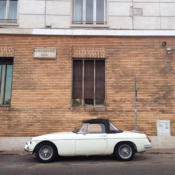 Retro white car near house - Free image #331539