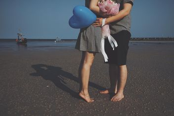 lovers on the beach - image #332869 gratis