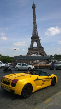 Yellow Rental Lamborghini in busy traffic near Eiffel Tower in Paris - бесплатный image #334229
