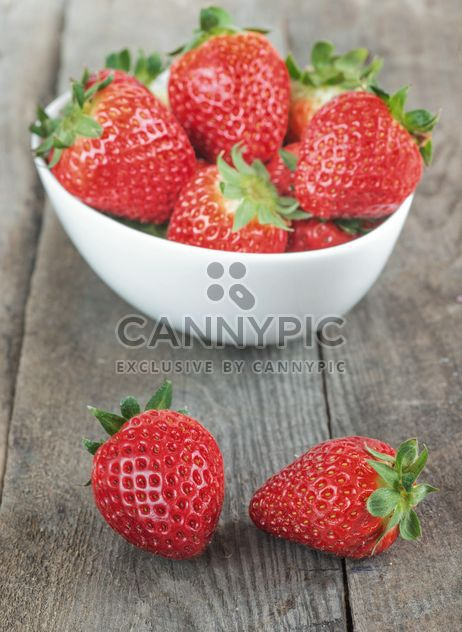 Small white china bowl filled with strawberries - Free image #334279