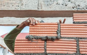 Construction worker laying bricks - Free image #338249
