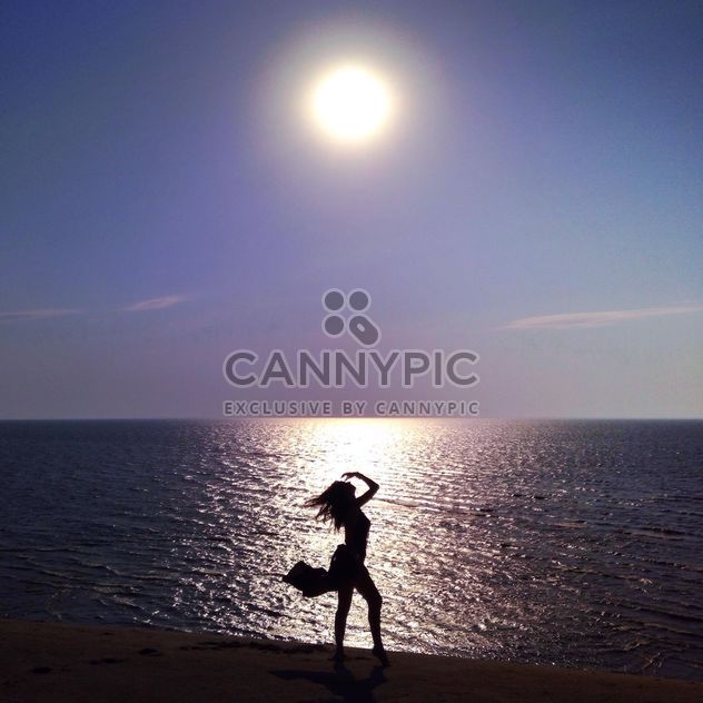 Girl on seashore at sunset - Free image #338479