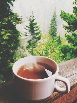 Cup of hot tea on balcony - Free image #339209