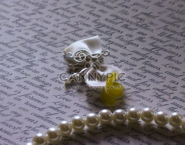 Caligraphic writing sheet with pearls and ribbon - Free image #341509
