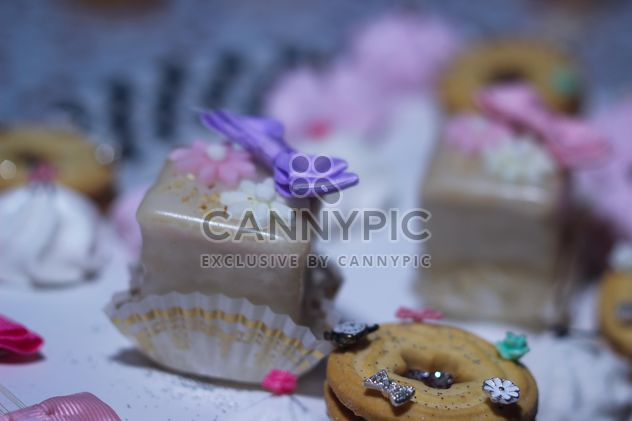 cookies decorated with flowers and ribbons - Free image #342119