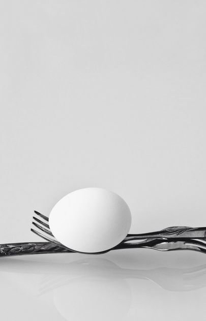 Chicken egg on forks on white background - бесплатный image #344599