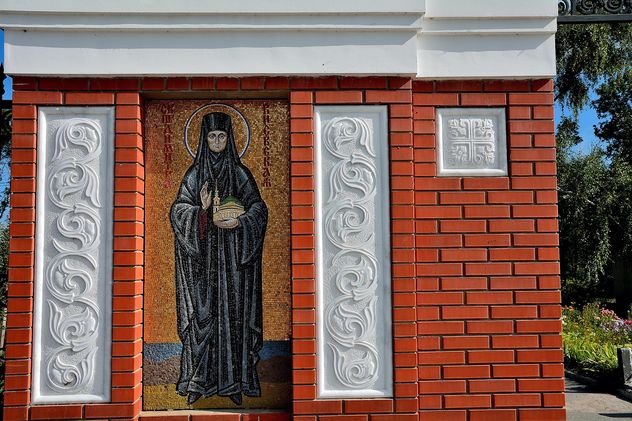 Fragment of monastery building with icon - бесплатный image #346279