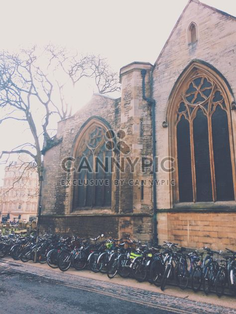 Bikes parked near building, England - бесплатный image #346909