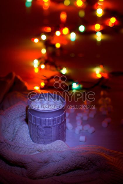 Cup of cocoa with marshmallows in light of garlands - Free image #347949