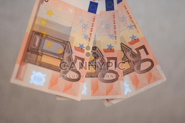 Closeup of Euro banknotes on grey background - Free image #348419