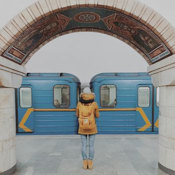 Girl standing on platform at subway station - бесплатный image #363699