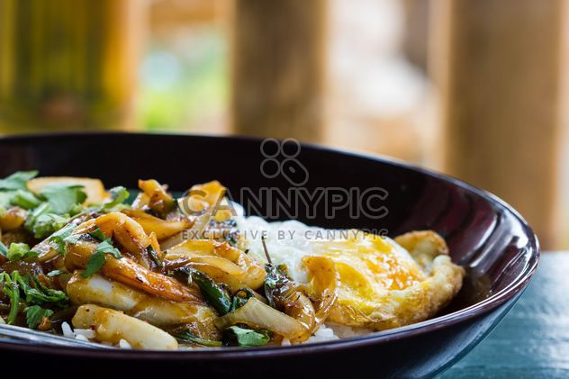 Seafood curry on rice with fried egg - Free image #439159