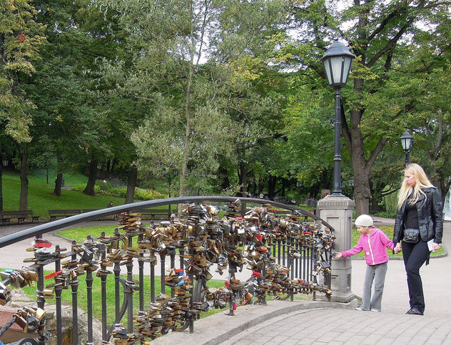 Latvia (Riga) Little girl interested in the love locks at bridge in Bastion Hill Park - Free image #448839