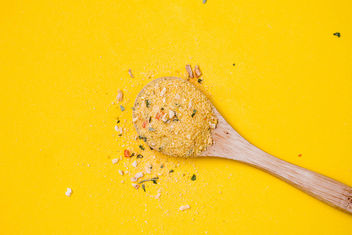 Top view of wooden spoon with yellow spice on yellow background - бесплатный image #448899