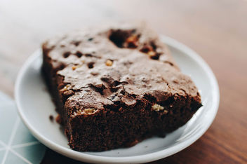 Close up of homemade chocolate brownie - image #452089 gratis