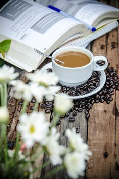 Cup of coffee, book and coffee beans - бесплатный image #452409
