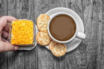 Cup of coffee with crackers and dessert - image #452439 gratis