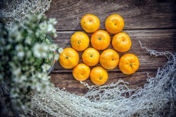 Tangerines on wooden background - бесплатный image #452499