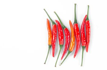 Red chili peppers on a white background - image #452609 gratis