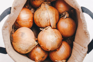 Group of onions in a sack. Top view - Free image #453599