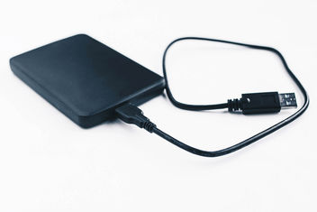 External hard drive on white background - image gratuit #453729