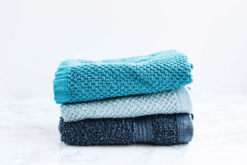 Set of three bath towels on white background - image #454039 gratis