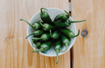 Top view of green spicy peppers on a wooden background.jpg - Free image #454859