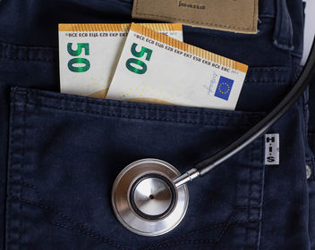 Medical Costs - A stethoscope with banknotes in the pocket of a pair of jeans - Free image #456819