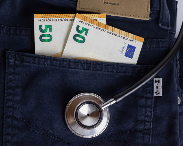 Medical Costs - A stethoscope with banknotes in the pocket of a pair of jeans - бесплатный image #456819