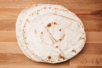 Top view of pita bread on wooden board - Free image #456979