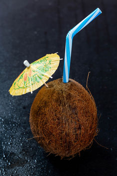 Coconut-cocktail-with-umbrella-and-straw.jpg - Free image #457619