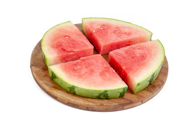 Sliced-Watermelon-arranged-on-the-round-wooden-board.jpg - Free image #462449