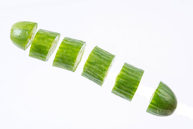 Sliced Mini Cucumber in the air above white background (Flip 2019) - image #462529 gratis