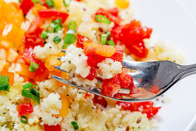 Close up of cooked porridge couscous with vegetables on a fork - image #464639 gratis
