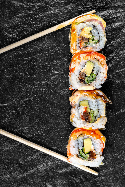 Sushi Rainbow Dragon on a black background with chopsticks - image #471989 gratis