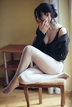 Woman in Wolford tights sitting on a chair closeup. - image #479739 gratis